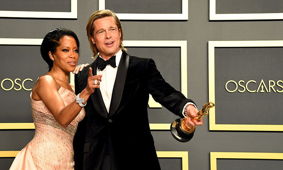 Brad and presenter <strong><a href=/tags/0/regina-king>Regina King</a></strong> hugged and gave each other kisses on the cheek backstage.