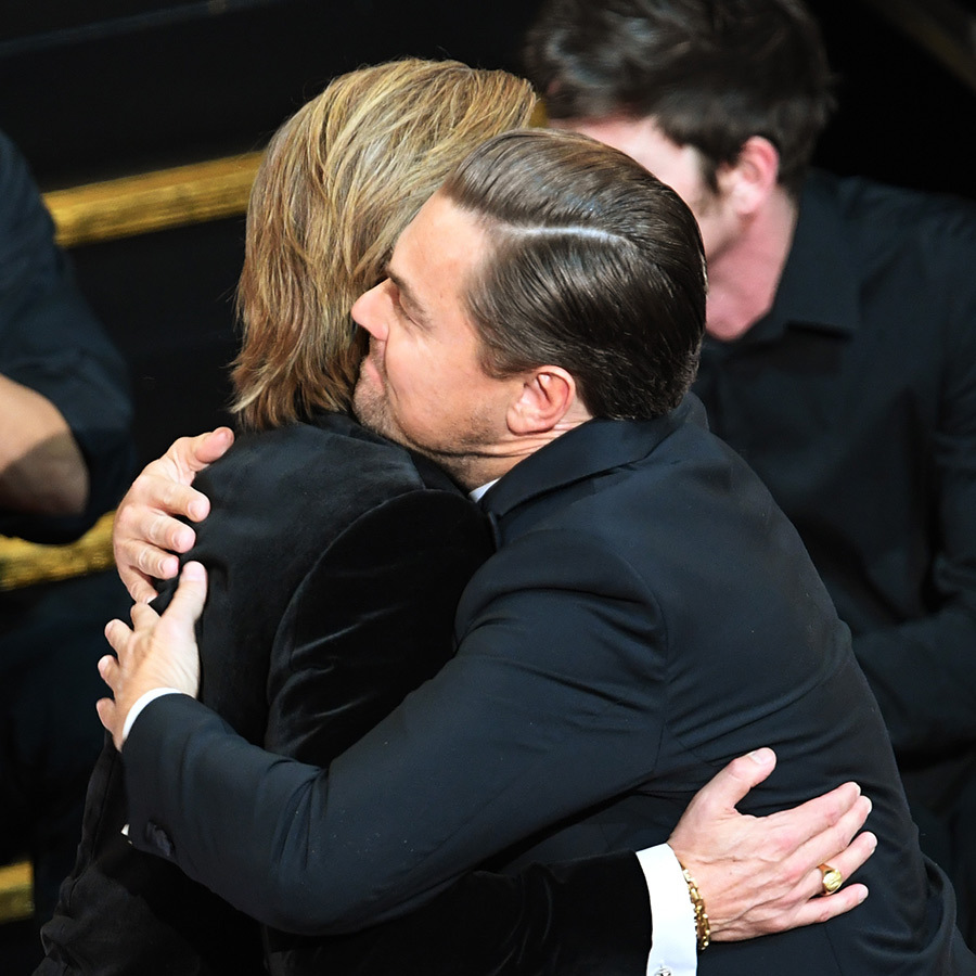 "This counts as saying hi, right? I mean, Brad and <strong><a href=/tags/0/leonardo-dicaprio>Leonardo DiCaprio</a></strong> said hello when they sat down next to each other at the Oscars, for sure, and a hug is basically a very large form of ""hi!"" and ""omg congrats!""