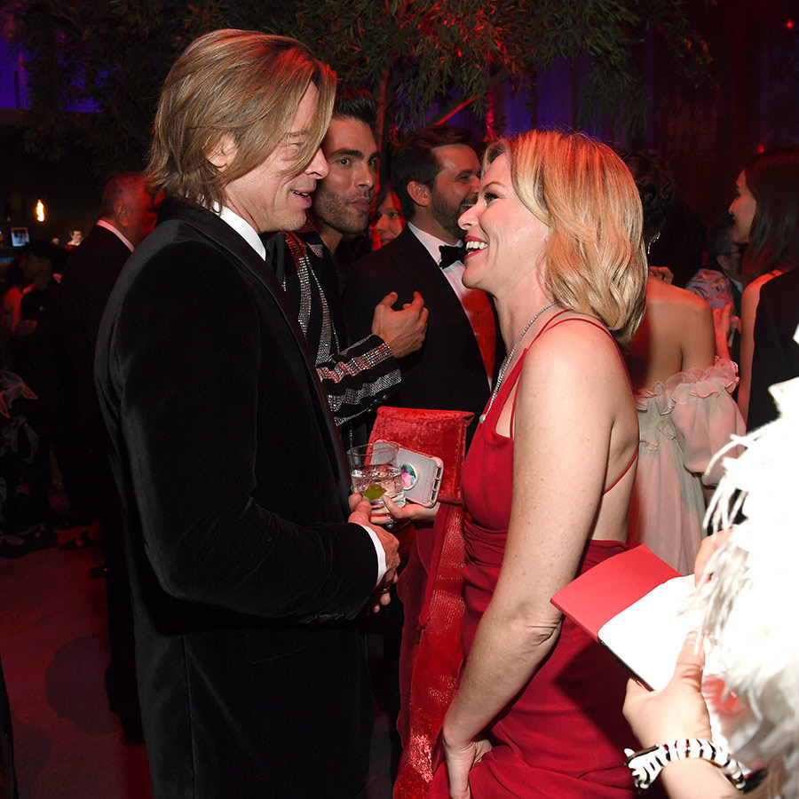 Brad's schmoozing continued at the Vanity Fair Oscars party, when he said hi to <strong><a href=/tags/0/elizabeth-banks>Elizabeth Banks</a></strong>. 