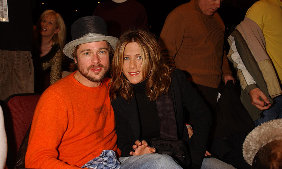 "<h2>2002</h2><p>Hollywood's ""Golden Couple"" cuddled up at <em>The Good Girl</em> premiere during the 2002 Sundance Film Festival. <p>Photo: &copy; George Pimentel/WireImage"