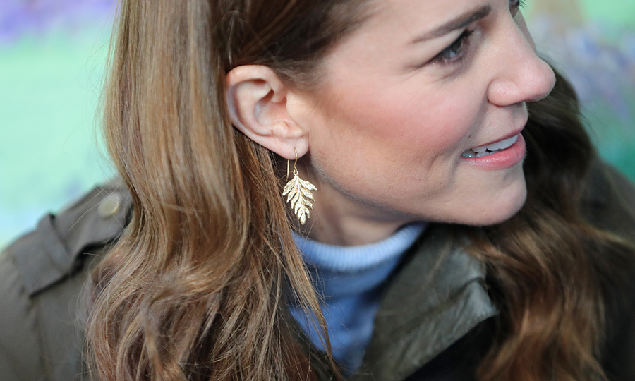 She was also wearing some gorgeous gold, leaf-shaped earrings!