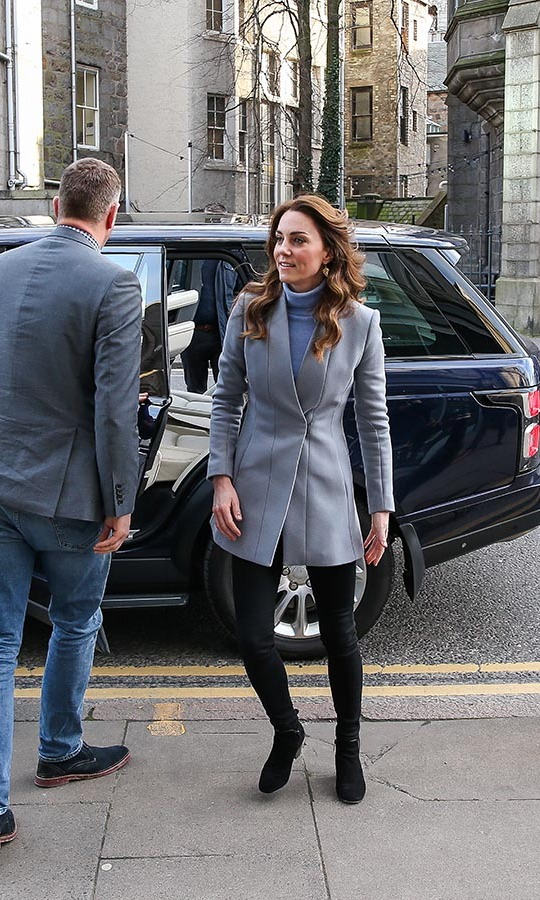 Outfit change! Also on Feb. 12, Duchess Kate made her way to the Social Bite cafe in Aberdeen, Scotland. The mom of three tweaked her ensemble by selecting a pastel blue tailored blazer and short black boots. She kept her original blue turtleneck, skinny black jeans and earrings.<p>Photo: © Paul Campbell/Getty Image