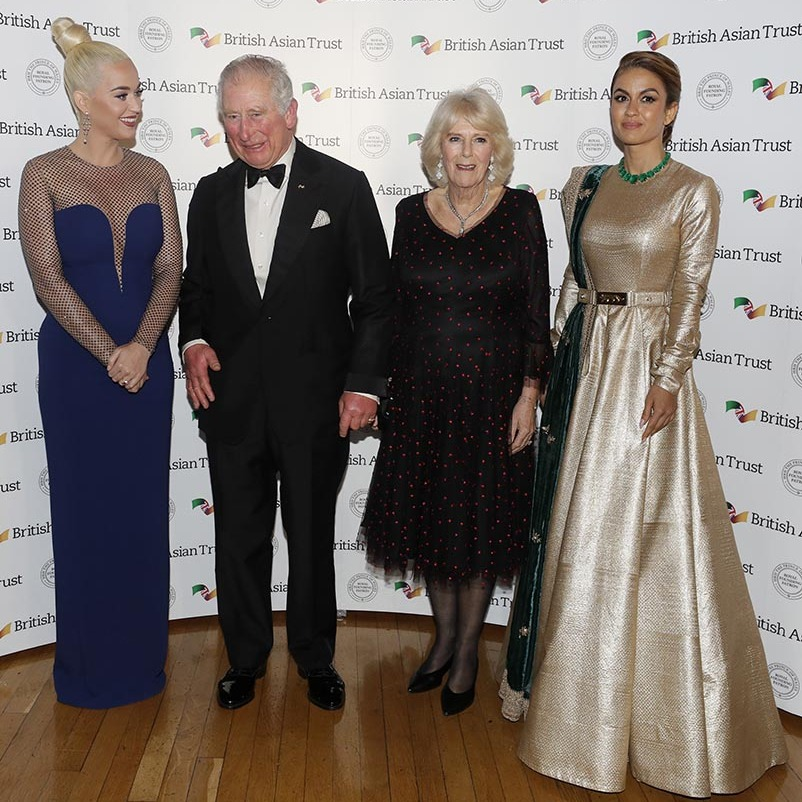 What a glamorous event! On Feb. 4, <a href=/tags/0/prince-charles><strong>Prince Charles</strong></a> and <a href=/tags/0/camilla-parker-bowles><strong>Duchess Camilla</strong></a> both looked very glamorous in black as they met <a href=/tags/0/katy-perry><strong>Katy Perry</strong></a> and Indian businesswoman <strong>Natasha Poonawalla</strong> at a reception in London for supporters of the British Asian Trust on Feb. 4. <p>Photo: &copy; Kirsty Wigglesworth - WPA Pool/ Getty Images