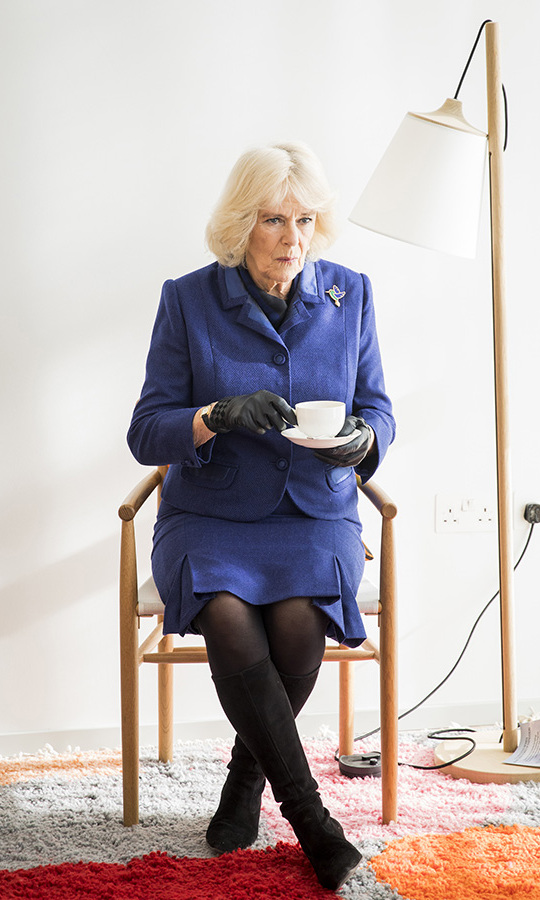 The <a href=/tags/0/camilla-parker-bowles><strong>Duchess of Cornwall</strong></a> cut an elegant figure in a navy skirt suit with black gloves, boots and tights during a royal engagement in Sutton, Greater London on Feb. 6.<p>Photo: &copy; Tristan Fewings/Getty Images
