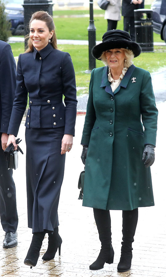 <a href=/tags/0/kate-middleton><strong>Duchess Kate</strong></a> and <a href=/tags/0/camilla-parker-bowles><strong>Duchess Camilla</strong></a> were so elegant at a rare joint engagement in Loughborough on Feb. 11 to visit the Defence Medical Rehabilitation Centre. Kate sported a navy <a href=/tags/0/alexander-mcqueen><strong>Alexander McQueen</strong></a> skirt suit while Camilla was outfitted in a resplendent <strong>Roy Allen</strong> ensemble featuring a flared green coat and black wide-brimmed hat. <p>Photo: © Chris Jackson/Getty Images