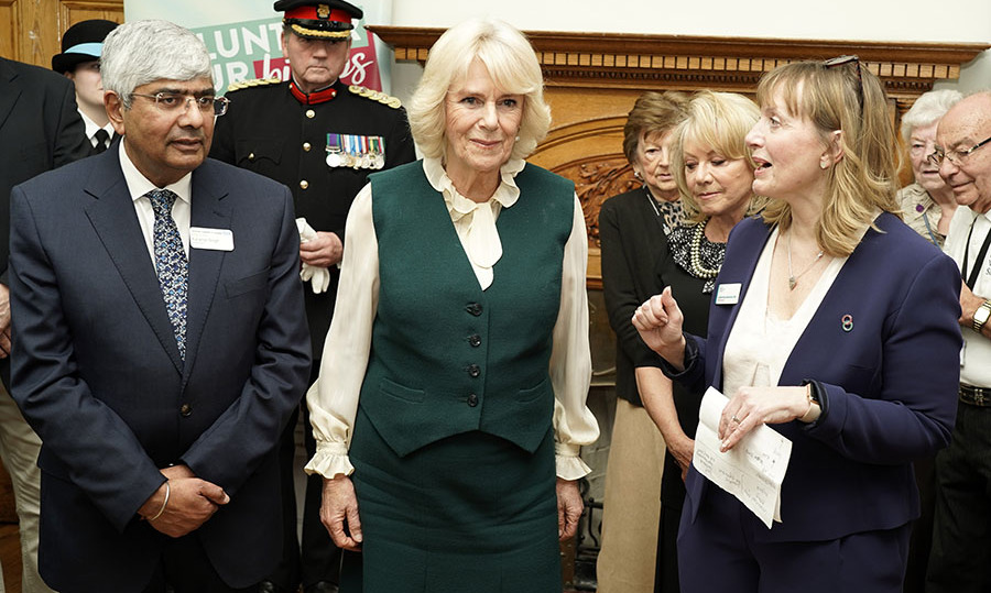 Also on Feb. 11, Camilla attended the launch of the Big Trolley Push charity campaign at Leicester's General hospital. She removed her coat to reveal her frilled blouse and coordinating vest and skirt. <p>Photo: &copy; Louis Wood - WPA Pool/Getty Images