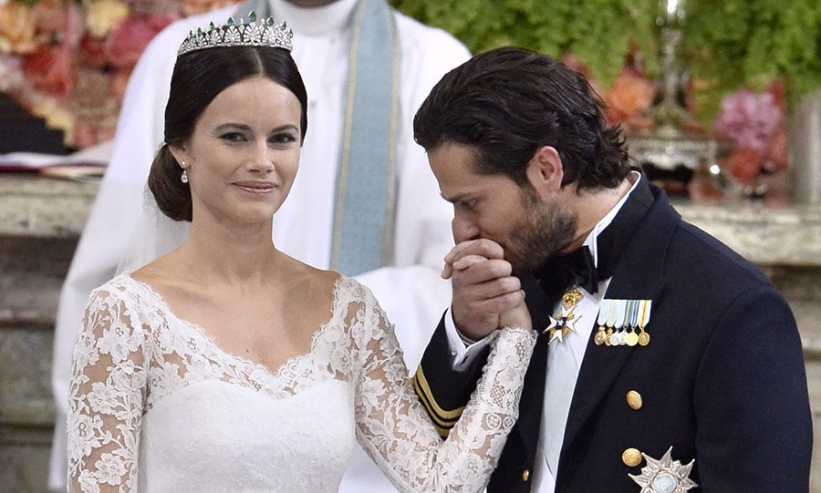 <a href=/tags/0/Prince-Carl-Philip><strong>Prince Carl Philip</strong></a> tenderly kissed <a href=/tags/0/princess-sofia><strong>Princess Sofia</strong></a>'s hand during their wedding ceremony at the Royal Chapel in Stockholm Palace on June 13, 2015.