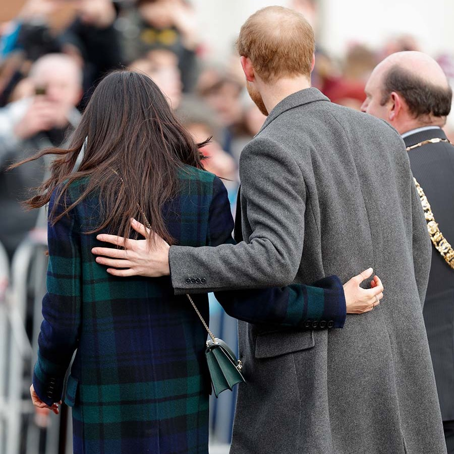 <a href=/tags/0/prince-harry-and-meghan><strong>Prince Harry and Meghan</strong></a> literally had each other's backs when they visited Edinburgh Castle on Feb. 13, 2018.