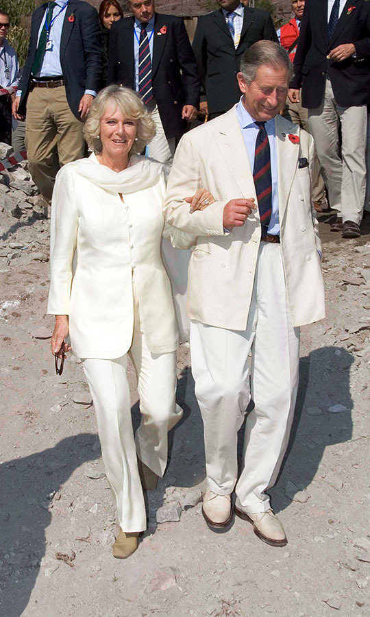 <a href=/tags/0/prince-charles><strong>Prince Charles</strong></a> and <a href=/tags/0/camilla-parker-bowles><strong>Duchess Camilla</strong></a> linked arms (and wore coordinating ivory ensembles!) while visiting Pakistan in Nov. 2006. <p>Photo: &copy; Pool/Tim Graham Picture Library/Getty Images