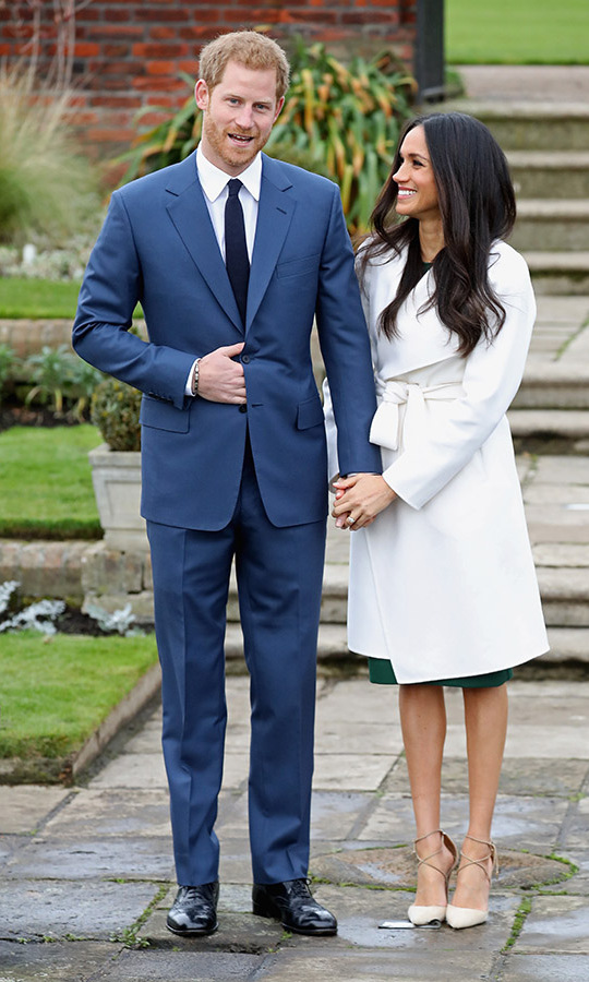 <a href=/tags/0/meghan-markle><strong>Duchess Meghan</strong></a> looked adoringly at <a href=/tags/0/prince-harry><strong>Prince Harry</strong></a> when the couple had their official photocall to announce the engagement at The Sunken Gardens at Kensington Palace on Nov. 27, 2017.