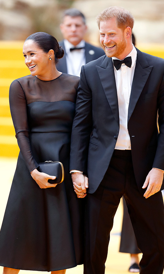 The <a href=/tags/0/prince-harry-and-meghan><strong>Duke and Duchess of Sussex</strong></a> looked giddy with love as they held hands at <em>The Lion King</em> European Premiere at Leicester Square on July 14, 2019.  