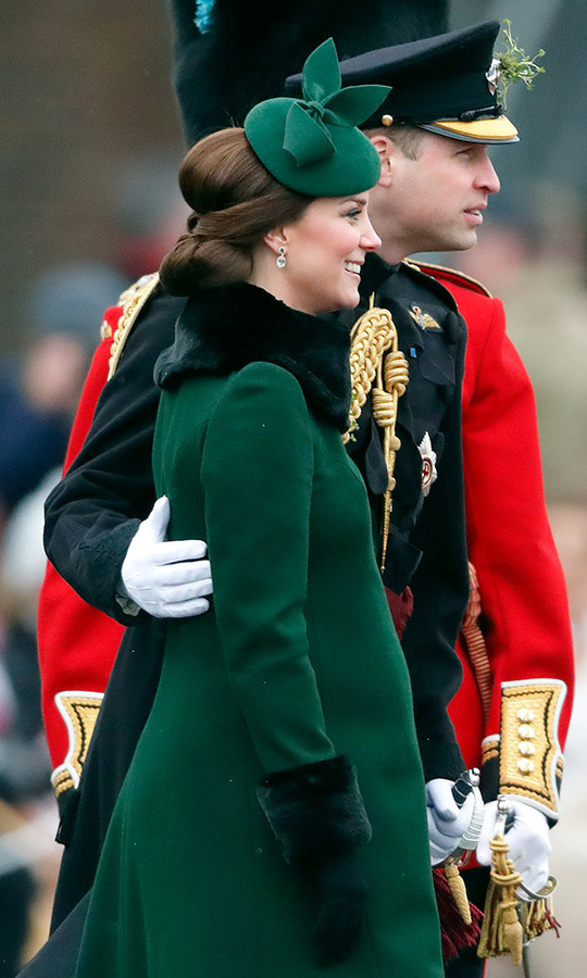 <a href=/tags/0/prince-wiliam><strong>Prince William</strong></a> placed a hand on wife <a href=/tags/0/kate-middleton><strong>Duchess Kate</strong></a>'s back during the Irish Guards St Patrick's Day Parade at Cavalry Barracks on March 17, 2018 in Hounslow, England. 