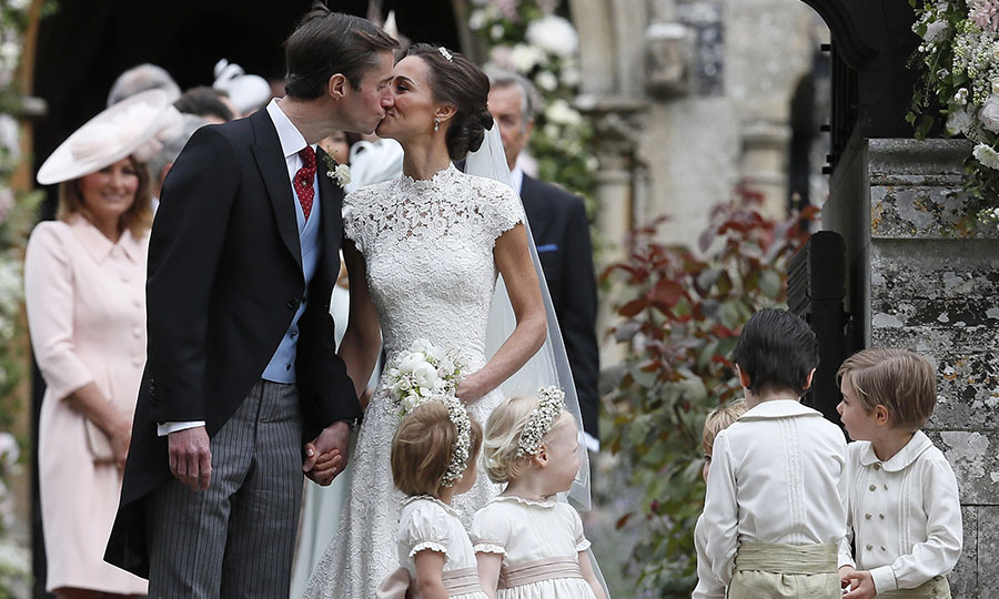 <a href=/tags/0/kate-middleton><strong>Duchess Kate</strong></a>'s sister <a href=/tags/0/pippa-middleton><strong>Pippa Middleton</strong></a> and her new husband <a href=/tags/0/james-matthews><strong>James Matthews</strong></a> shared a happy peck following their wedding ceremony at St. Mark's Church on May 20, 2017 in Englefield, England.