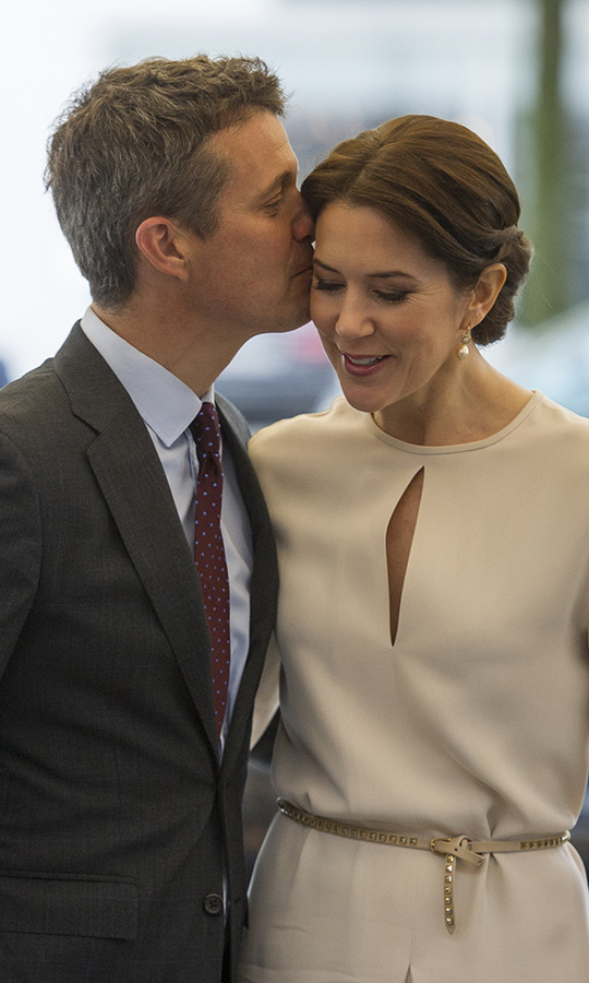 <a href=/tags/0/Crown-Prince-Frederik><strong>Crown Prince Frederik</strong></a> planted a kiss on wife <a href=/tags/0/Crown-Princess-Mary><strong>Crown Princess Mary</strong></a> during a visit to Munich in 2015.