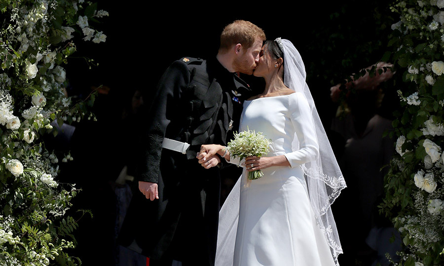 Royals fans remember the smooch between <a href=/tags/0/prince-harry><strong>Prince Harry </strong></a> and <a href=/tags/0/meghan-markle><strong>Duchess Meghan</strong></a> outside St. George's Chapel in Windsor Castle after their wedding on May 20, 2018.