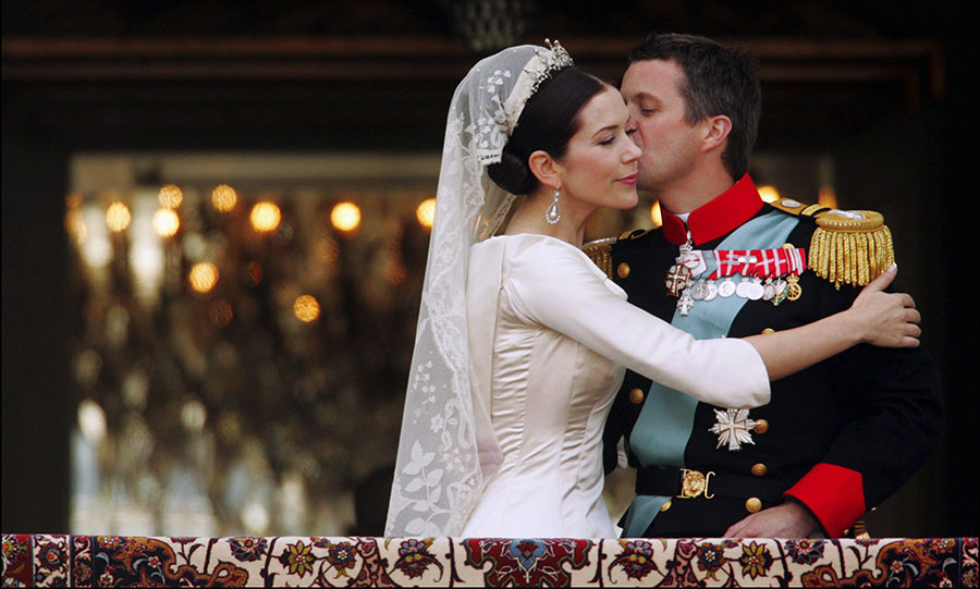 At the wedding of <a href=/tags/0/Crown-Prince-Frederik><strong>Crown Prince Frederik</strong></a> and now-<a href=/tags/0/crown-princess-mary><strong>Crown Princess Mary</strong></a> in  Copenhagen on May 14, 2004, the newly married couple shared an affectionate moment on a balcony.