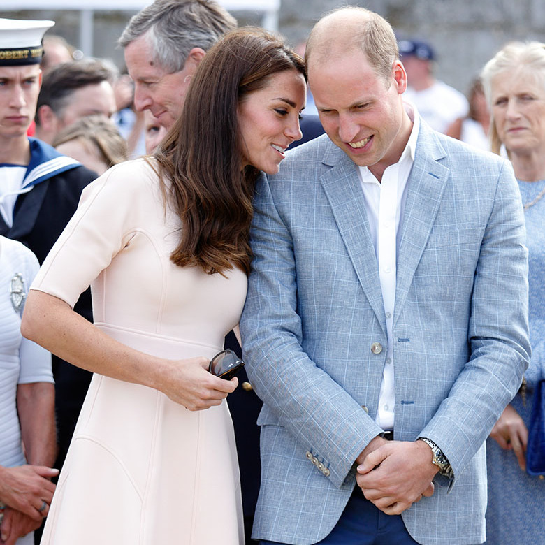 <a href=/tags/0/kate-middleton><strong>Duchess Kate</strong></a> leaned in to <a href=/tags/0/prince-william><strong>Prince William</strong></a> to share a private moment during a visit to Newquay in September 2016. 