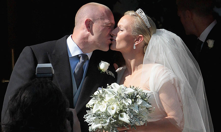 <a href=/tags/0/mike-tindall><strong>Mike Tindall</strong></a> and <a href=/tags/0/zara-tindall><strong>Zara Tindall</strong></a> made things official with a kiss as they left the church after their marriage at Canongate Kirk on July 30, 2011 in Edinburgh. 