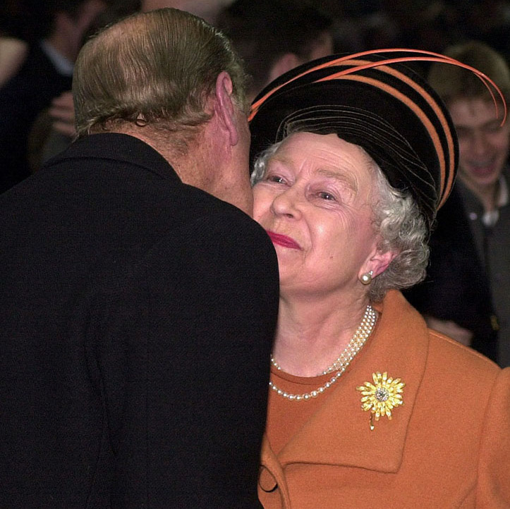 The <a href=/tags/0/prince-philip><strong>Duke of Edinburgh</strong></a> sweetly kissed <a href=/tags/0/queen-elizabeth-ii><strong>the Queen</strong></a> on the cheek during millennium celebrations on Dec. 31, 1999.