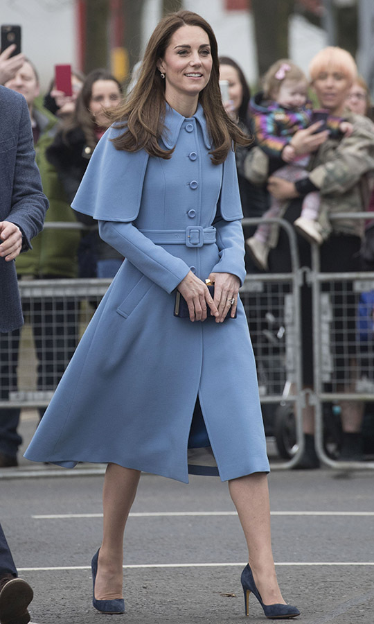 "On Feb. 28, 2019, Kate made a memorable impression in Ballymena, Northern Ireland in a beautiful blue coat by <a href=""https://ca.hellomagazine.com/tags/0/mulberry"" target=""_blank""><strong>Mulberry</strong></a>. The cape detailing and belted waist had such a refined finish. She added a bit more blue with her navy accessories. <p>Photo: © Stephen Lock - Pool/Getty Images"