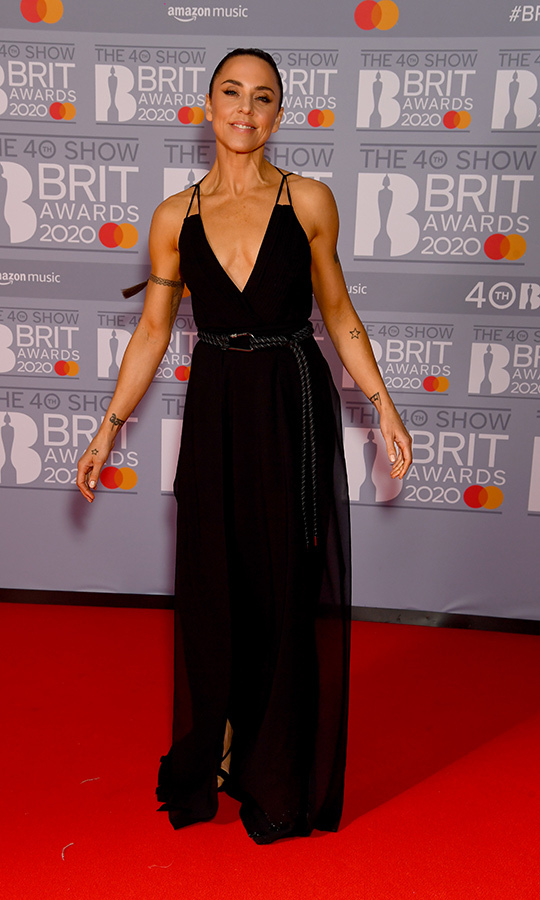 Spice up your life! <Strong><a href=/tags/0/melanie-c>Melanie C</a></strong> looked incredible as always in this spaghetti strap dress, which she paired with a plaited belt. 