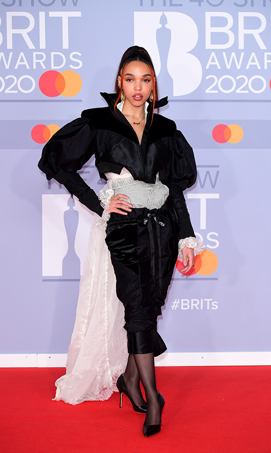 <a href=/tags/0/fka-twigs><strong>FKA Twigs</a></strong> chose a very '80s-inspired look by London designer <strong>Ed Marler</strong>.