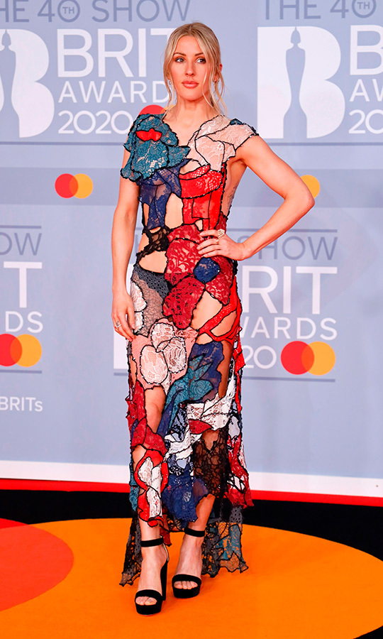 <strong><a href=/tags/0/ellie-goulding>Ellie Goulding</a></strong> chose a very edgy floral gown with cutout patterns.