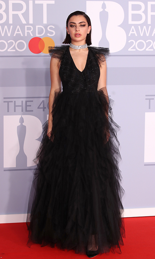<a href=/tags/0/charli-xcx><strong>Charli XCX</a></strong> chose a black <strong><a href=/tags/0/fendi>Fendi</a></strong> tulle gown, which she paired with matching heels and a diamond choker. 