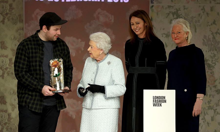 <a href=/tags/0/queen-elizabeth-ii><strong>The Queen</strong></a> presented fashion designer <a href=/tags/0/richard-quinn><strong>Richard Quinn</strong></a> with the first Queen Elizabeth II Award for British Design on Feb. 20, 2018 during London Fashion Week. She also watched the designer's runway show! <p>Photo: © Tim Whitby/BFC/Getty Images