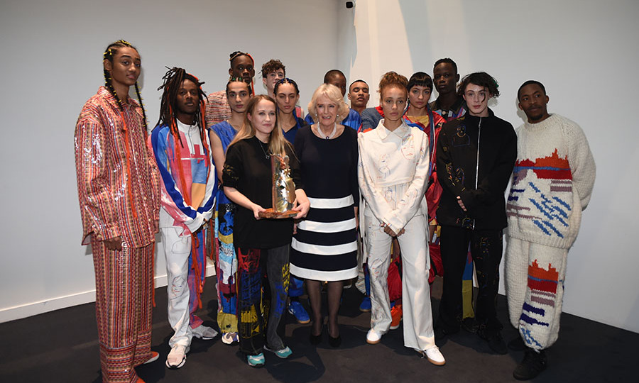 <a href=/tags/0/camilla-parker-bowles><strong>Duchess Camilla</strong></a> poses with fashion designer <strong>Bethany Williams</strong> and models after the designer's London Fashion Week show on Feb. 19, 2019. The duchess presented the designer with the 2019 Queen Elizabeth II Award. <p>Photo: © Eddie Mulholland - WPA Pool/Getty Images