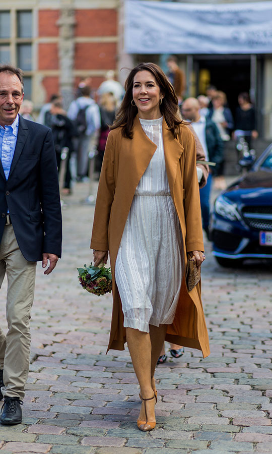 <a href=/tags/0/crown-princess-mary><strong>Crown Princess Mary</strong></a> attended the Copenhagen Fashion Week Spring/Summer 2017 shows in August 2016 in a white dress and toffee-coloured coat.