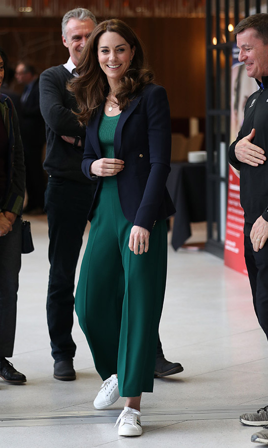 "The Duchess of Cambridge topped the look with a navy blue blazer from one of her go-to Canadian brands, <a href=""https://ca.hellomagazine.com/tags/0/smythe""><strong>Smythe</strong></a>.<p>Photo: © Yui Mok - WPA Pool/Getty Images"