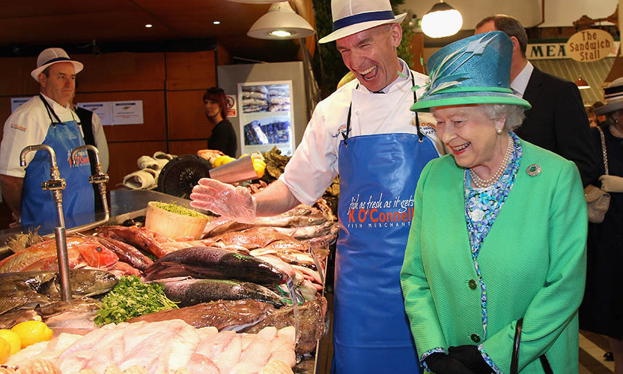The Queen and fishmonger <strong>Pat O'Connell</strong> shared a laugh during her engagement at the English Market on May 20, 2011 in Cork. <p>Photo: &copy; Chris Jackson - Pool/Getty Images