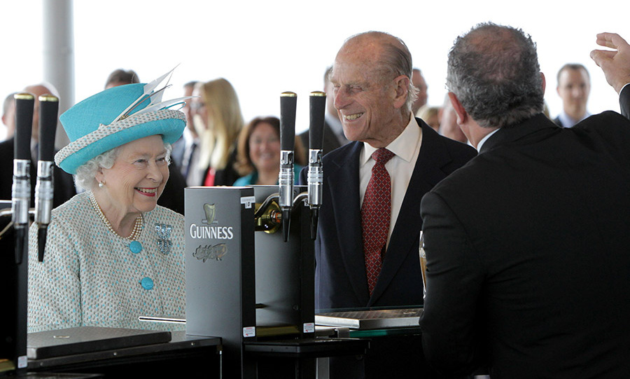 Pour a pint of the black stuff, please! The Queen and Prince Philip visited the Guinness Storehouse in Dublin and watched the pouring of a pint in May 2011.<p>Photo: &copy; Irish Government - Pool/Getty Images