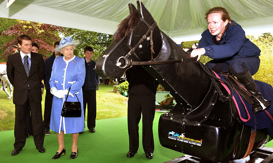 Her Majesty is an avid horse lover. On May 19, 2011 in Kildare, Ireland, she and Iris jockey <strong>Johnny Murtagh</strong> studied a horse racing simulator during the Irish National Stud.<p>Photo: &copy; Samir Hussein/WireImage