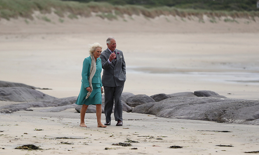 The Prince of Wales and Camilla, Duchess of Cornwall enjoyed a scenic walk on Derrynane beach in County Kerry on June 15, 2018. The duchess even removed her shoes! <p>Photo: &copy; Niall Carson - WPA Pool/Getty Images