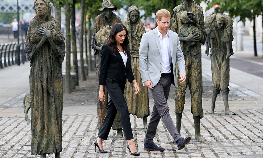 Harry and Meghan took in the Famine Memorial statues by Irish sculptor <strong>Rowan Gillespie</strong> in Dublin on the final day of their Ireland tour. <p>Photo: © Paul FAITH / AFP