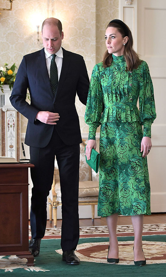 During a meeting with the President of Ireland, <strong>Michael D. Higgins</strong>, Kate removed her coat to reveal the intricate details of her frock, including the pleated bodice, balloon sleeves and swirling green pattern.<p><a href=/tags/0/prince-william><strong>Prince William</strong></a> subtly coordinated with his wife and paid tribute to Ireland with his dark green tie!<p>Photo: © Samir Hussein/WireImage