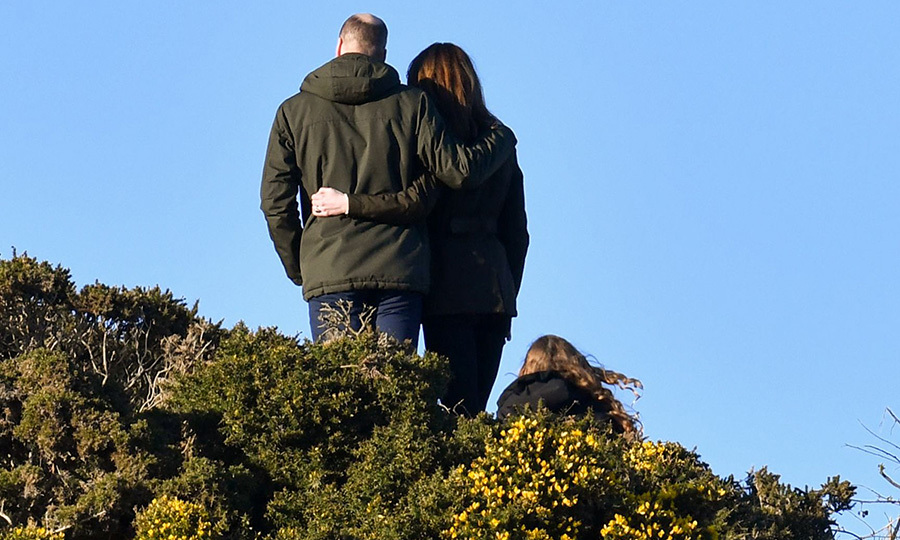 At the top of the cliff, they took in the amazing view across the Irish Sea and lovingly put their arms around each other.
