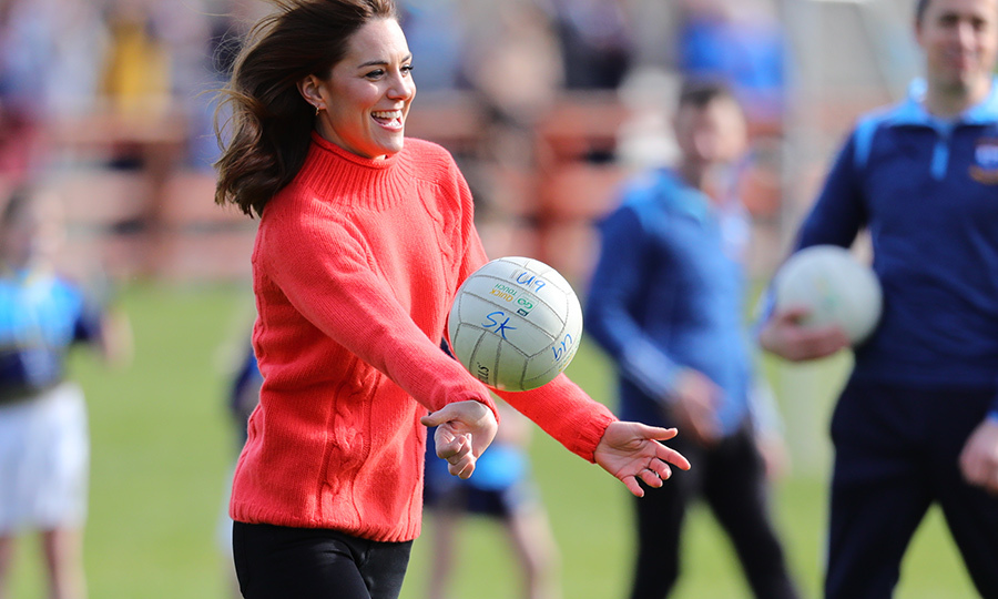 It's safe to say the duchess, who was clad casually in a salmon cable-knit sweater and black jeans, really liked Gaelic soccer!
