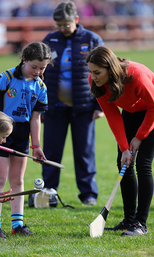 A group of youngsters also taught them how to play hurling.