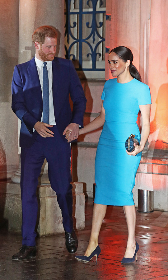 The couple were holding hands and smiling as they left. 