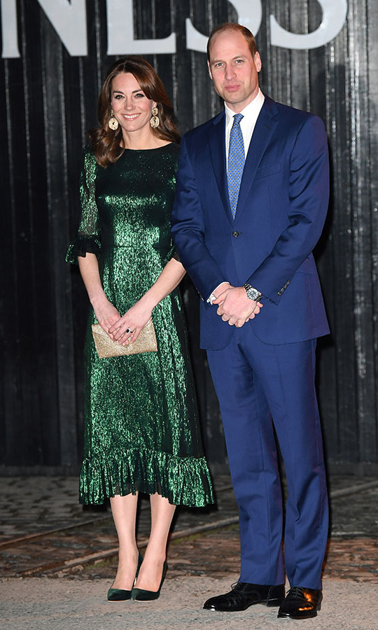 "Also on March 3, the Duke and Duchess of Cambridge visited the Guinness Storehouse's Gravity Bar in Dublin. She stunned in a metallic green dress by <a href=""https://ca.hellomagazine.com/tags/0/the-vampires-wife""><strong>The Vampire's Wife</strong></a> paired with budget-friendly oversized <a href=/tags/0/hm><strong>H&M</strong></a> earrings, a shimmering clutch and deep green <a href=/tags/0/manolo-blahnik><strong>Manolo Blahnik</strong></a> heels.<p>Photo: © Karwai Tang/WireImage"