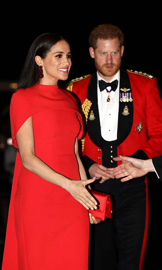The two were smiling as they arrived, looking thrilled to be there. Meghan was also wearing some very stylish <strong>Simone Rocha</strong> earrings.