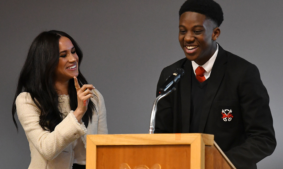 "Meghan then asked young men to tell her – and the women and girls listening – what the day meant to them. Head Boy <strong>Aker Okoye</strong>, 16, came up to do the honours. He started by giving the duchess a kiss on the cheek, and the cheekily said, ""She really is beautiful, innit?"" Meghan laughed and gave him a playful wag of the finger. 