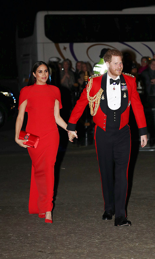 "<strong><a href=""https://ca.hellomagazine.com/tags/0/meghan-markle"">Duchess Meghan</a></strong> looked sensational in head-to-toe red when she and <a href=""https://ca.hellomagazine.com/tags/0/prince-harry""><strong>Prince Harry</strong></a> attended the Mountbatten Festival of Music at Royal Albert Hall on March 7. She was clad in a <strong>Safiyaa</strong> short-sleeved gown, burgundy floral earrings by <strong>Simone Rocha</strong>, a <a href=""https://ca.hellomagazine.com/tags/0/manolo-blahnik""><strong>Manolo Blahnik</strong></a> clutch and <strong><a href=""https://ca.hellomagazine.com/tags/0/aquazzura"">Aquazzura</a></strong> heels.