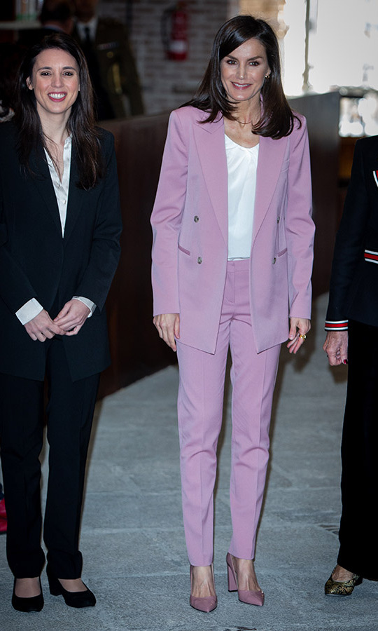 <a href=/tags/0/queen-letizia><strong>Queen Letizia</strong></a>'s cheerful pale pink suit and coordinating pumps brightened up the day when she attended a meeting with the APRAMP (Prostitution Women Association) on March 6 in Madrid. 