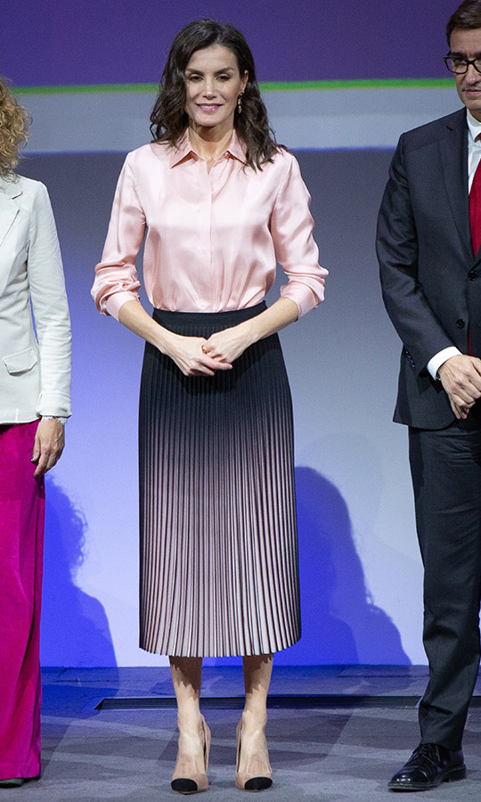 <a href=/tags/0/queen-letizia><strong>Queen Letizia</strong></a> of Spain was elegant in a pale pink silky blouse with a striking black and soft pink ombré skirt at the Rare Diseases World Day event at BBVA headquarters in Madrid on March 5.
