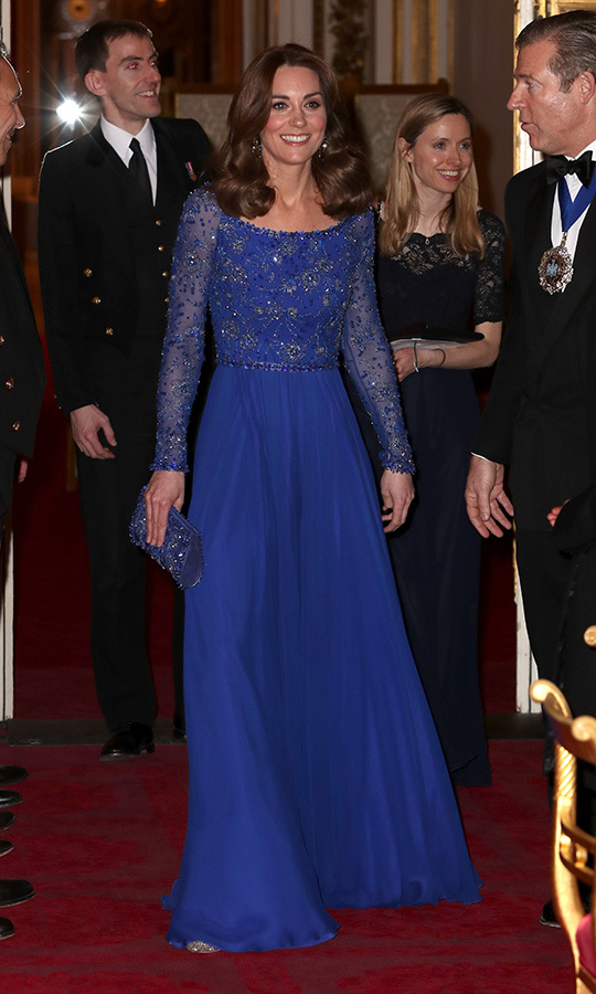 Kate looked gorgeous in her secnod look of the day, stepping out in a navy, beaded <strong><a href=/tags/0/jenny-packham>Jenny Packham</a></strong> gown with silver <Strong><a href=/tags/0/jimmy-choo>Jimmy Choo</a></strong> heels and a matching clutch.