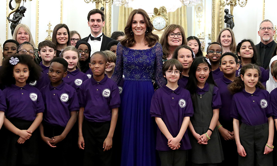 Everyone posed for a group picture as the event kicked off! Kate adorably matched the youngsters' uniforms.